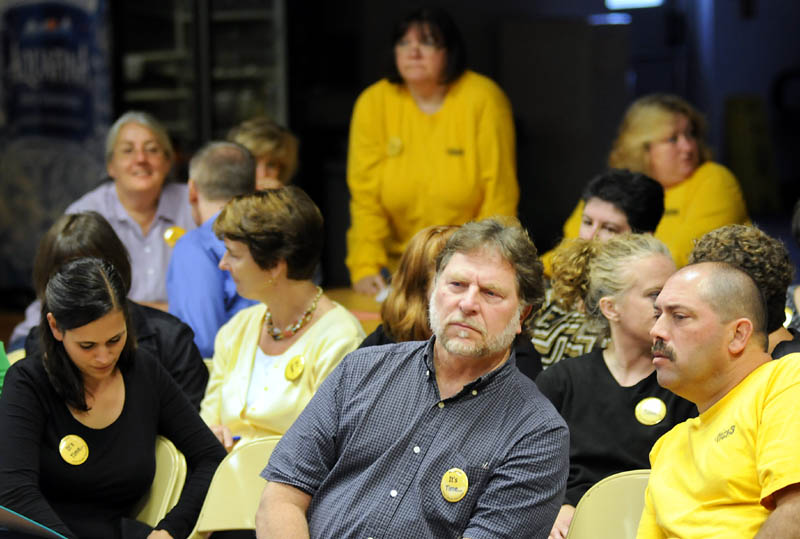 SOLIDARITY: Wearing yellow buttons and yellow t-shirts, teachers from throughout the Maranacook school system attended a school board meeting in Readfield on Wednesday to protest working without a contract for two years.
