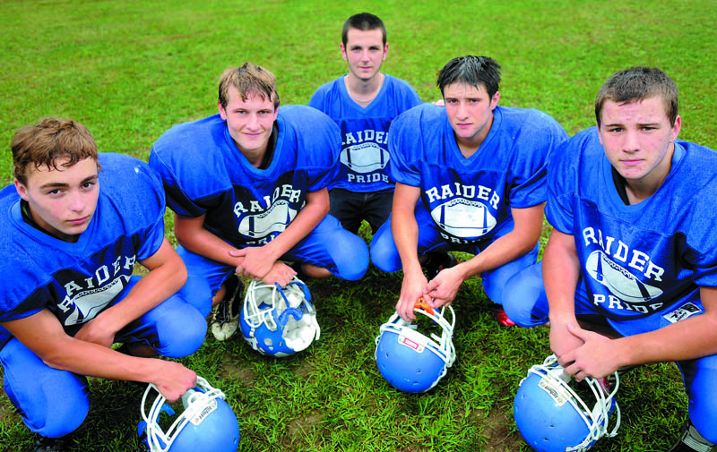 Staff photo by Andy Molloy RUNNING HARD: Oak Hill High School's running backs are, from left, Alex Mace, Kyle Flaherty, Joel Wells, Brandon Potvin and Aaron Clark.
