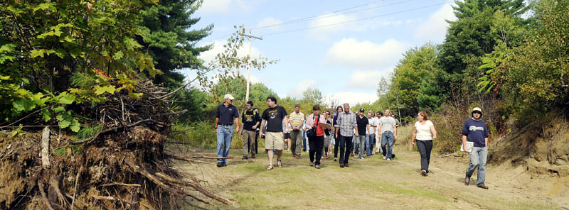 Dr. William Rogers, left, leads University of Maine at Augusta architecture students down a trail Thursday at the Bond Brook Recreation Area in Augusta. The students toured the trails for skiers, hikers and bikers to design a lodge proposal.
