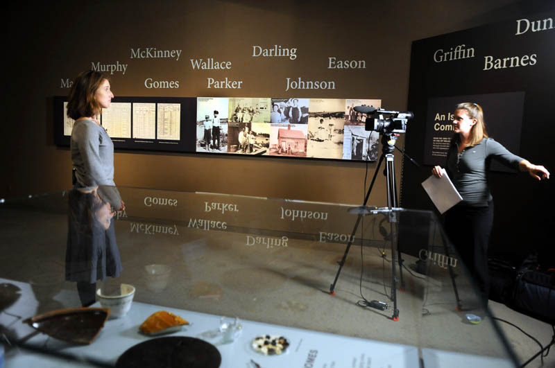 """C-SPAN video journalist Adrienne Hoar, right, interviews Maine State Museum Curator of Historic Collections Kate McBrien on Monday in the exhibition """"Malaga Island, Fragmented Lives."""" The network is visiting various historic and literary sites and interviewing local historians, authors and state officials, with the resulting productions to be broadcast on two cable TV channels next month."""