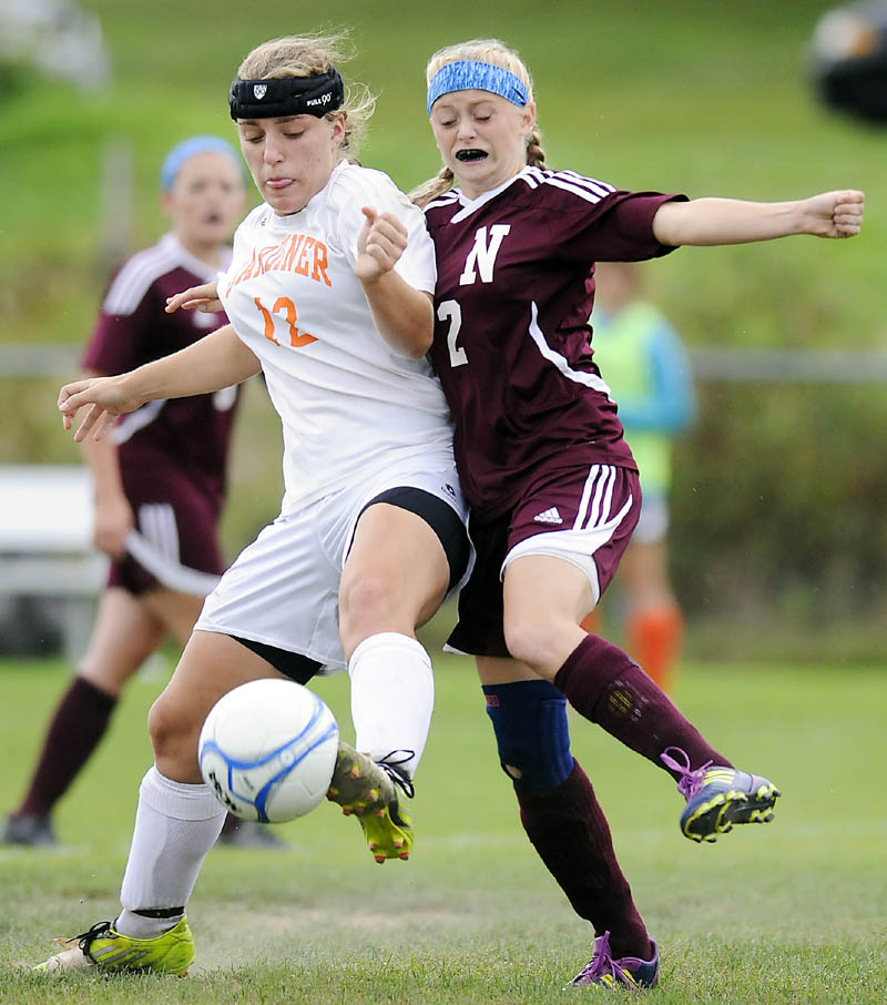 STEPPING UP: Gardiner Area High School's Ally Day, left, tips the ball away from Nokomis High School's Audrey Temple during the Tigers' 4-2 win Tuesday in Gardiner.