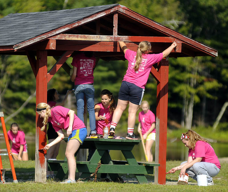 CARE: Hall-Dale High School students paint a picnic shelter Wednesday at the Hallowell recreation area during the school's first Day of Caring. About 100 students enrolled in the Jobs for Maine's Graduates program, Key Club and National Honor Society worked on projects across Hallowell during the school's first public service day, according to Lydia Leimbach, who coordinated the effort.