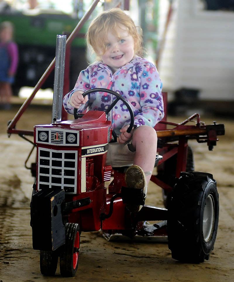 Elora Bogdanski, 3, of South Bristol, peddles to a first place finish Sunday in the 33 pound class of the Kiddie Tractor Pull at the Windsor Fair.