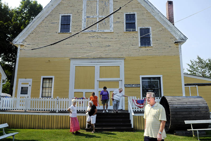 """Visitors tour the carriage house Thursday at the Monmouth Museum on Main Street in Monmouth. A new book, """"Recalling Monmouth's Greatest Turf and Farm Era,"""" about the agricultural history of the community is raising funds for the care of the Museum."""
