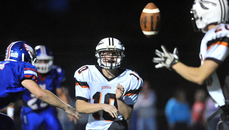 MAKING PLAYS: Adam Clukey is in his first year as the starting quarterback for the Skowhegan Area High School football team, which is running a new spread offense. Clukey has thrown for 855 yards and seven touchdowns.