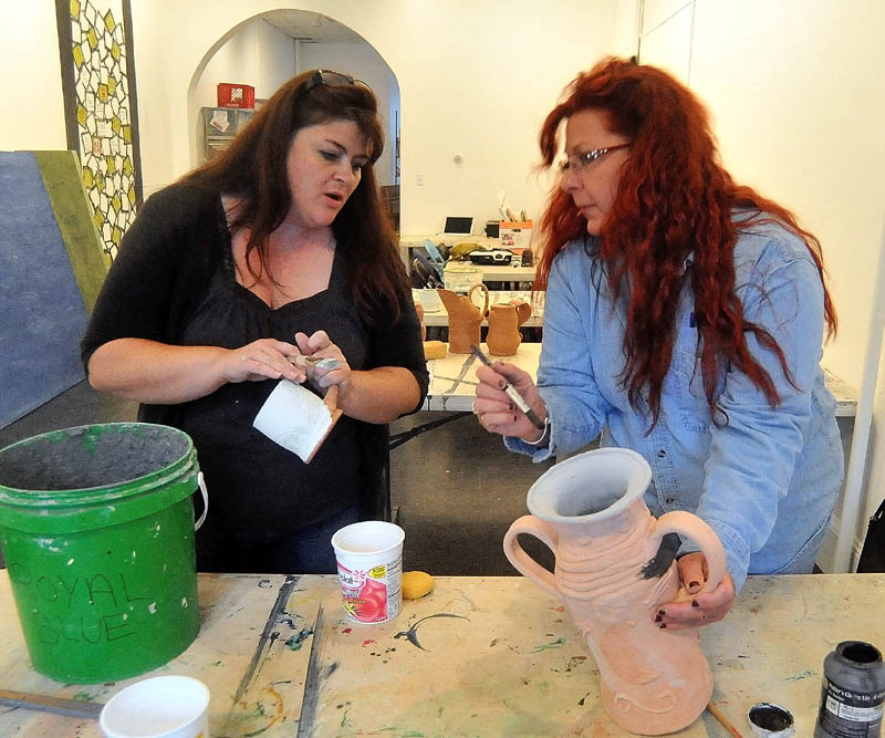 Tracey Steuber, right, receives pottery instruction from art teacher Kimberly Bently, left, Tuesday during Open Studio at Common Street Arts in Waterville. Open Studio happens every Tuesday from 5 to 8 p.m. and costs $10 per student.