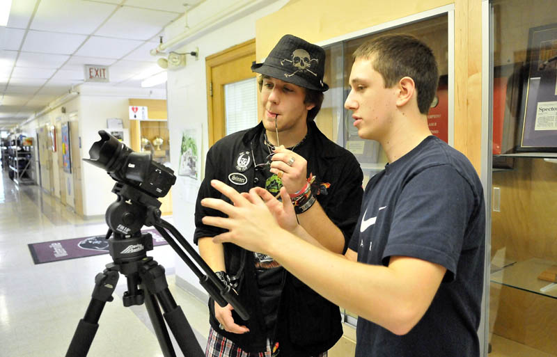 Staff photo by Michael G. Seamans Messalonskee High School seniors, Eric Mathews, left, and Dustin Wood, right, work out camera agnles as they shoot a 35 second video during Mass Media Communication's class at Mid-Maine Technical Center at waterville Senior High School Thursday.