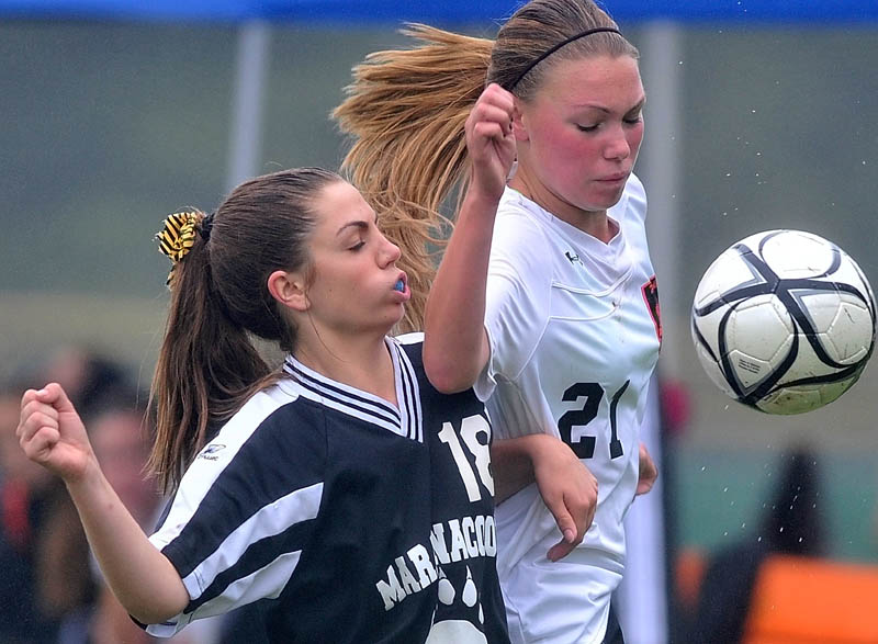 Staff photo by Michael G. Seamans Maranacook Community High School's Sarah Clough, 18, left, battles with Winslow High School's Kamryn Michaud, 21, right for the ball in the second half of soccer action in Winslow Saturday.