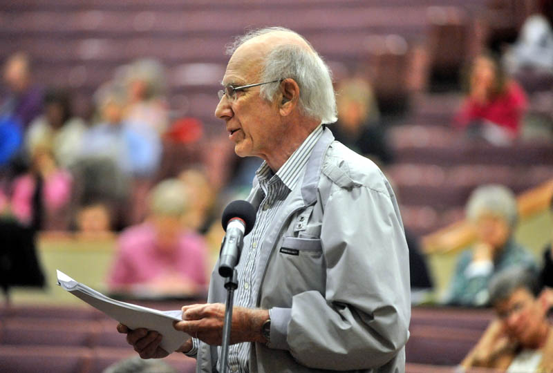 Staff photo by Michael G. Seamans Peter McKenney, a former teacher at Messalonskee High School speaks his thoughts to those assmebled for the RSU 18 district budget meeting at Messalonskee High School for the current school year on Thursday.
