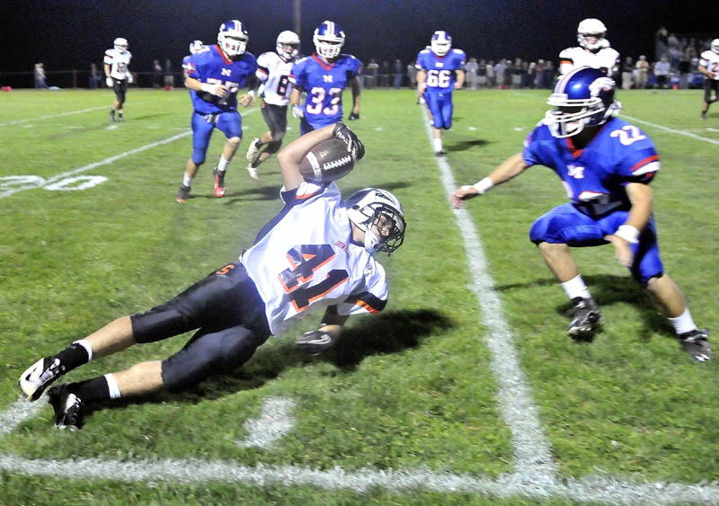 Skowhegan High School's Kaleb Brown, 41, dives for extra yards on a kick-off return in the second quarter at Messalonskee High School in Oakland Friday night.