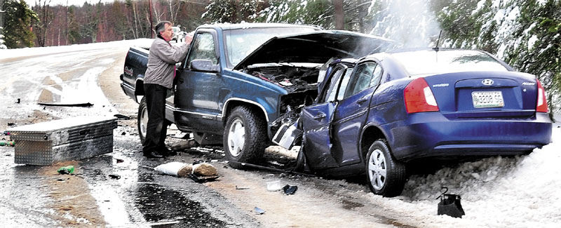 Frank Keithan of Troy speaks with two injured occupants of a pickup truck Jan. 19, 2011, after a head-on collision with a Hyundai that killed the woman driving the sedan. The crash happened on a slush-covered stretch of Route 139 in Unity Township.