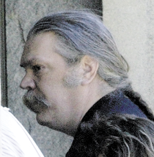 Mark Bechard walks into Kennebec County Superior Court in Augusta for a court appearance in 2006.