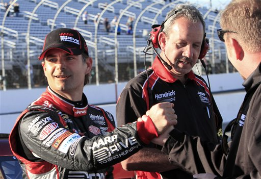 Jeff Gordon celebrates with his team after winning the pole position for Sunday's NASCAR Sprint Cup Series auto race at New Hampshire Motor Speedway in Loudon, N.H., Friday, Sept. 21, 2012. (AP Photo/Jim Cole)
