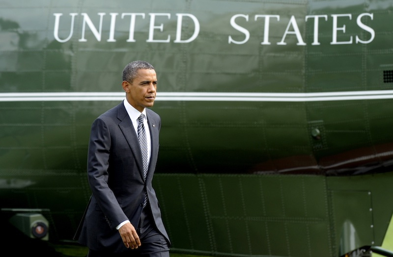 President Barack Obama walks to the Oval Office of the White House in Washington, Friday, Sept. 14, 2012, after arriving on Marine One on the South Lawn. Obama went to Andrews Air Force Base to attend the transfer of remains ceremony marking the return to the United States of the remains of the four Americans killed this week in Benghazi, Libya. (AP Photo/Susan Walsh)