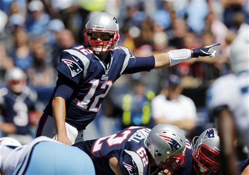 New England Patriots quarterback Tom Brady (12) calls a play in the first quarter of an NFL football game against the Tennessee Titans on Sunday, Sept. 9, 2012, in Nashville, Tenn. (AP Photo/Joe Howell) LP Field