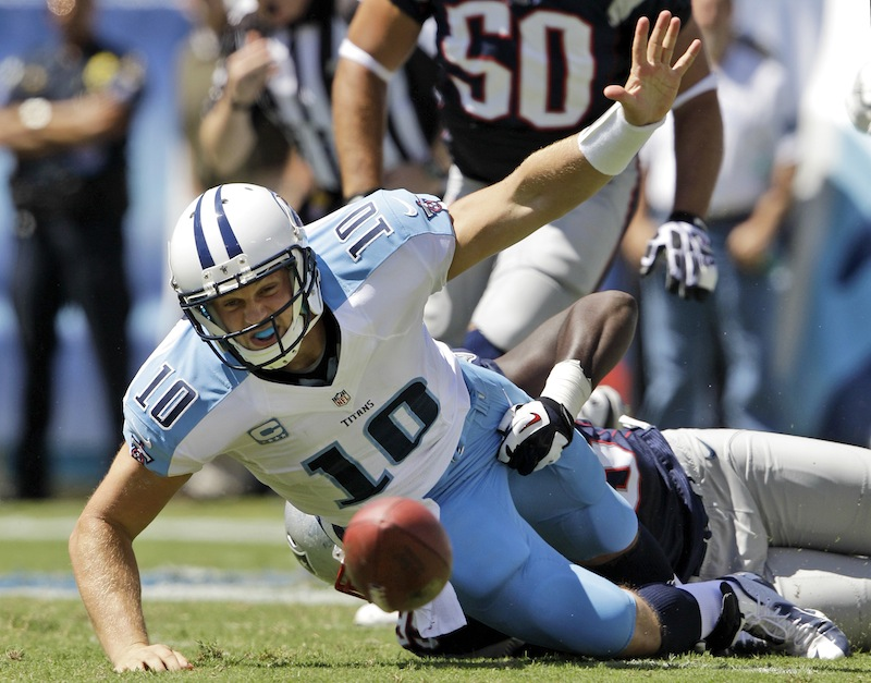 Tennessee Titans quarterback Jake Locker (10) loses the ball as he is hit by New England Patriots defensive end Chandler Jones (95) in the second quarter of an NFL football game, Sunday, Sept. 9, 2012, in Nashville, Tenn. New England Patriots linebacker Dont'a Hightower recovered the ball and ran for a touchdown. (AP Photo/Wade Payne) LP Field