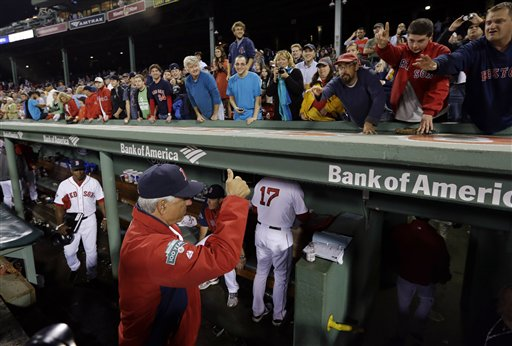 Boston Red Sox manager Bobby Valentine gestures a thumbs-up to fans after their last home baseball game of the season at Fenway Park in Boston, against the Tampa Bay Rays, Wednesday, Sept. 26, 2012. The Rays won 4-2. (AP Photo/Elise Amendola)