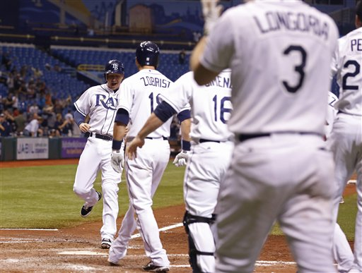 Tampa Bay Rays Elliot Johnson scores a run in the bottom of the ninth inning against the Boston Red Sox of a baseball game, Thursday, Sept. 20, 2012, in St. Petersburg, Fla. (AP Photo/Scott Iskowitz)