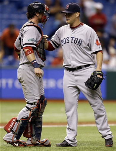 Boston Red Sox relief pitcher Andrew Bailey, right, celebrates with catcher Jarrod Saltalamacchia after closing out the Tampa Bay Rays during the ninth inning of a baseball game, Tuesday, Sept. 18, 2012, in St. Petersburg, Fla. Boston won the game 7-5. (AP Photo/Chris O'Meara) Tropicana Field