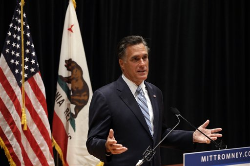 Republican presidential candidate Mitt Romney speaks to reporters on Monday about remarks he made on a secretly taped video from one of his campaign fundraising events.
