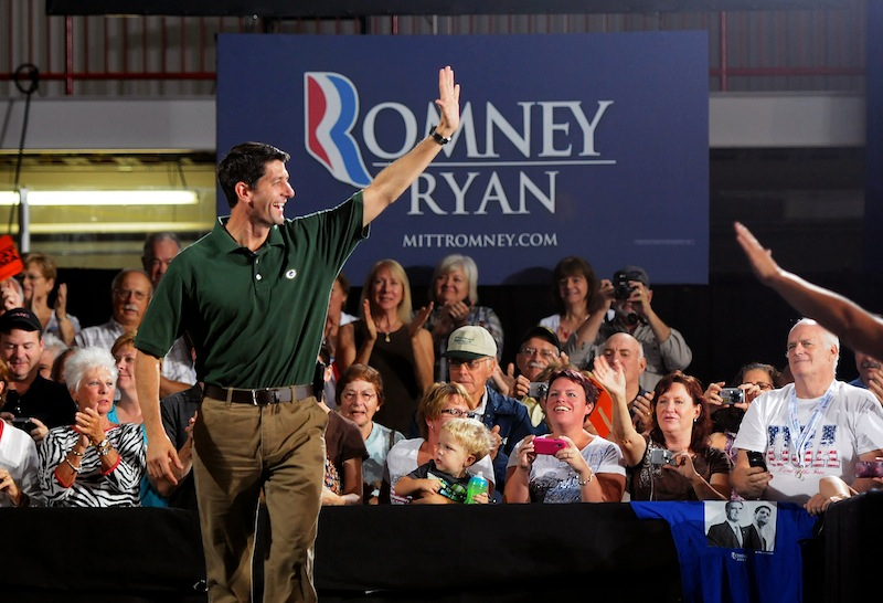 Republican vice presidential candidate, Rep. Paul Ryan, R-Wis. greets his supporters as he walks on stage to deliver a town hall speech at the Cornerstone Community Ice Center in Ashwaubenon, Wis., on Wednesday, Sept. 12, 2012. (AP Photo/The Green Bay Press-Gazette, Lukas Keapproth)