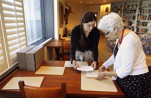 Hemingway curator Susan Wrynn, right, and intern Jessica Green collate documents from the Hemingway collection at the John F. Kennedy Library and Museum in Boston. The Associated Press photo