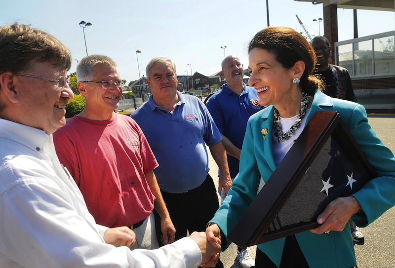"""Retiring U.S. Senator Olympia Snowe, R-Maine, says goodbye to Portsmouth Naval Shipyard workers from left, Mark Nelson, Paul O'Connor, Arvard Worster, Mike Melhorne and Jeffery Phillips, after a ceremony held in Kittery, Maine, Friday, Sept. 14, 2012. Snowe is writing a """"memoir and a call to action"""" about Washington's hyper-partisan atmosphere, due out in 2013 after she steps down. (AP Photo/The Herald, Deb Cram)"""