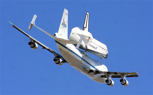 The retired shuttle Endeavour piggy-backs a modified Boeing 747 Shuttle Aircraft Carrier Thursday over White Sands Missile Range east of Las Cruces, N.M.