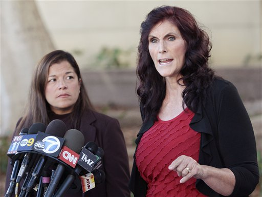 """Cindy Lee Garcia, right, one of the actresses in """"Innocence of Muslims,"""" and attorney M. Cris Armenta hold a news conference before a hearing at Los Angeles Superior Court in Los Angeles on Thursday."""