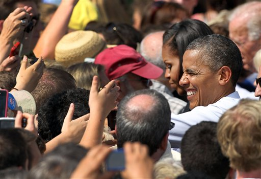 President Barack Obama greets supporters during a campaign stop , Friday, Sept. 7, 2012, in Portsmouth, N.H. (AP Photo/Jim Cole)