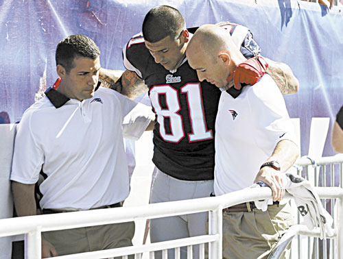 BAD BREAK: New England Patriots tight end Aaron Hernandez is helped from the field with an ankle injury in the first quarter against the Arizona Cardinals on Sunday in Foxborough, Mass. ESPN2 reported Hernandez will not play Sunday night against Baltimore.