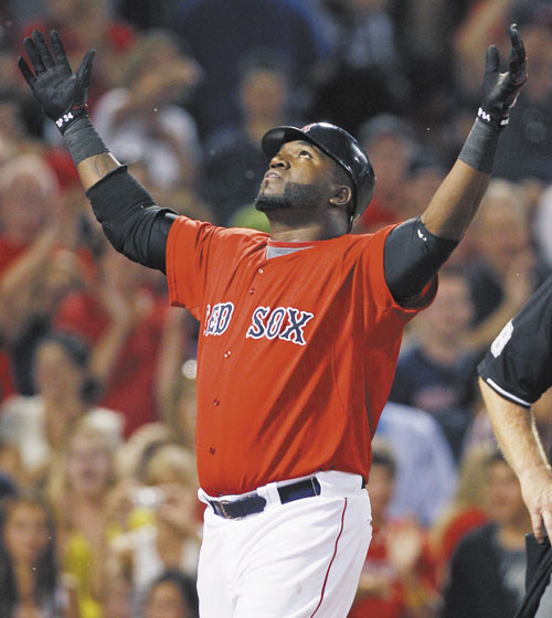LOOKING FORWARD: Boston'sDavid Ortiz, center, was batting .318 with 23 homers and 60 RBIs before going down with an Achilles earlier this season. Ortiz is a free agent next year.