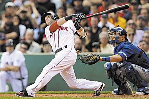 BRIGHT SPOT: Boston's Dustin Pedroia follows through on his home run against the Toronto Blue Jays during the sixth inning Sunday at Fenway Park in Boston.