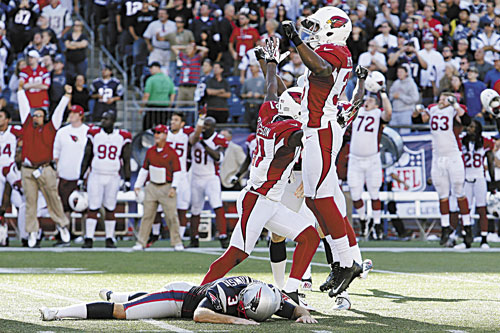 WIDE LEFT: Arizona Cardinals cornerback Justin Bethel, right, and teammates celebrate after New England Patriots kicker Stephen Gostkowski, bottom, missed a field at the end of the fourth quarter Sunday in Foxborough, Mass. The Cardinals won 20-18.