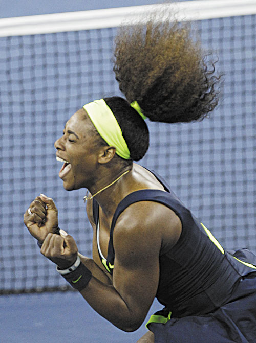 JOYOUS OCCASION: Serena Williams reacts after beating Victoria Azarenka in the championship match at the U.S. Open tennis tournament Sunday in New York. Two points from defeat, Williams suddenly regained her composure to come back and win the last four games, beating No. 1-ranked Azarenka 6-2, 2-6, 7-5 for her fourth U.S. Open title and 15th Grand Slam title overall.