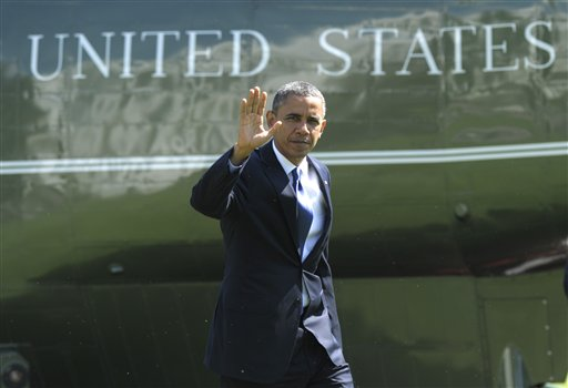President Barack Obama walks off of Marine One at the White House in Washington, Friday, Sept. 21, 2012, after campaigning in Virginia. (AP Photo/Susan Walsh)