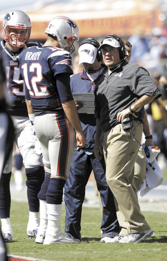 HEADING HOME: Tom Brady (12) and Bill Belichick, right, lead the New England Patriots into their home opener today against the Arizona Cardinals. The Patriots beat the Cardinals 47-7 in the last meeting between the two teams. LP Field