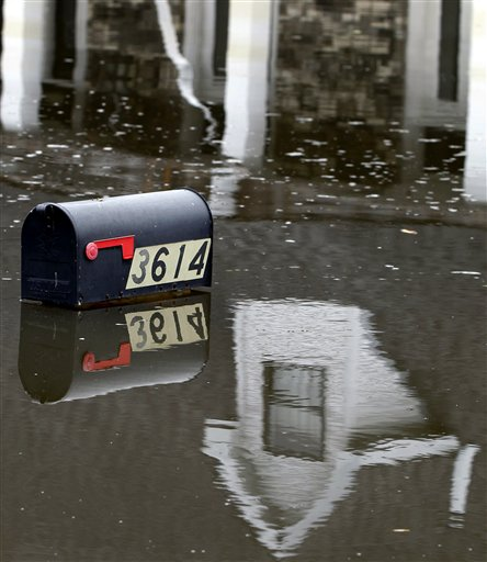 A mailbox peeks above floodwaters from Hurricane Isaac in Braithwaite, La., Sunday, Sept. 2, 2012. More than 200,000 people across Louisiana still didn't have any power five days after Hurricane Isaac ravaged the state. Thousands of evacuees remained at shelters or bunked with friends or relatives. (AP Photo/Gerald Herbert)