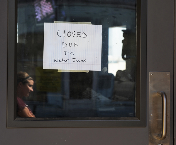 """A sign on the Porthole restaurant says it was """"closed due to water issues"""" Friday. Employees later replaced the sign with one that read: """"Closed, sorry for the inconvenience."""""""