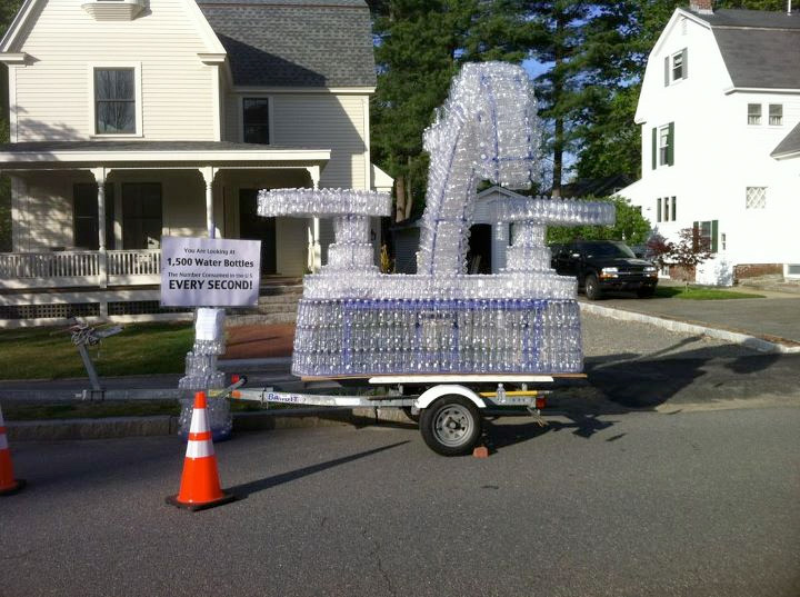 The town of Concord, Mass has banned the sale of plastic water bottles. This photo was taken in April following an Earth Day parade in downtown Concord. The sculpture, made of plastic water bottles, protests their overuse and damage to the environment they cause.