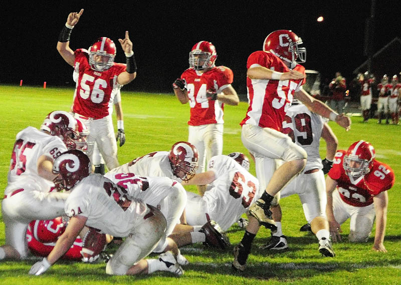 TIME TO CELEBRATE: The Cony defense celebrates after scoring a safety to take a 9-7 lead over Bangor during the second quarter Friday night at Alumni Field in Augusta.