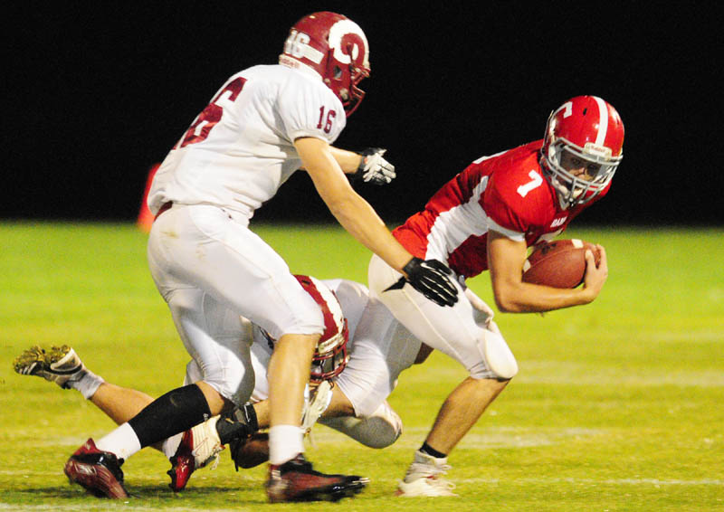 TANDEM TAKEDOWN: Bangor defenders Nick Ashley, top, and Matt Cosgrove tackle Cony's Chandler Shostak during a game Friday night at Alumni Field in Augusta.