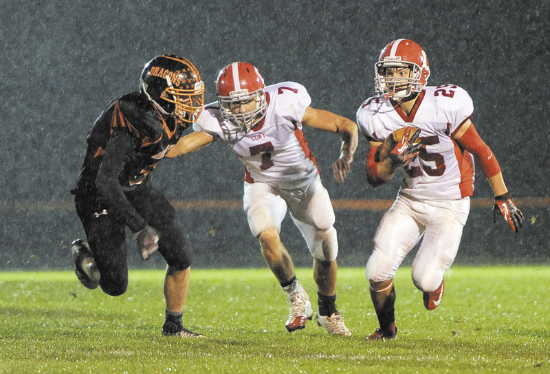 COMING THROUGH: Cony High School's Tayler Carrier carries the ball while getting a block from teammate Chandler Shostak during the Rams' 34-7 win over Brunswick on Friday in Brunswick.
