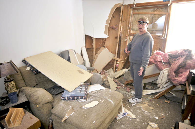 Jim Pinkham stands in his apartment this morning telling the story of how a vehicle crashed through the wall on Friday evening at 36 Water Street in Augusta.