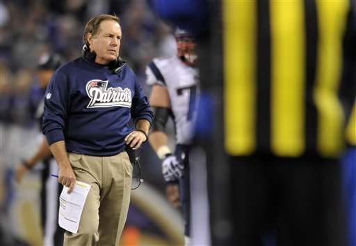 New England Patriots head coach Bill Belichick is seen past an official as he looks on in the second half of an NFL football game against the Baltimore Ravens in Baltimore, Sunday, Sept. 23, 2012. (AP Photo/Gail Burton)