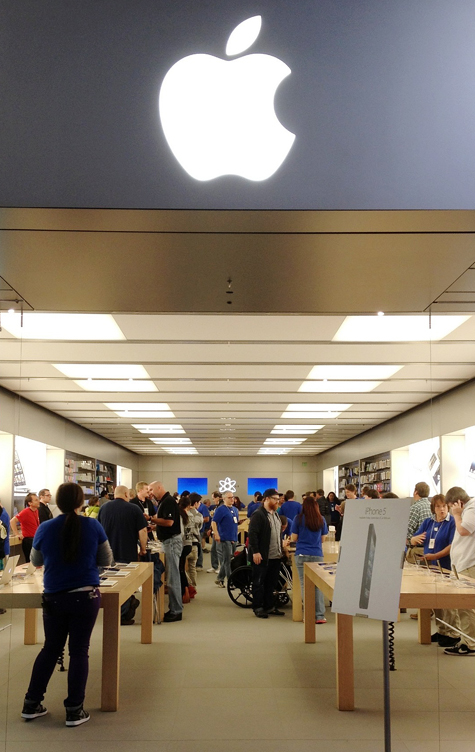 Customers fill the Apple Store at The Maine Mall in South Portland on Friday morning to buy the iPhone 5. Over 100 people waited in line for hours for a chance to buy the phone on the first day it was available.