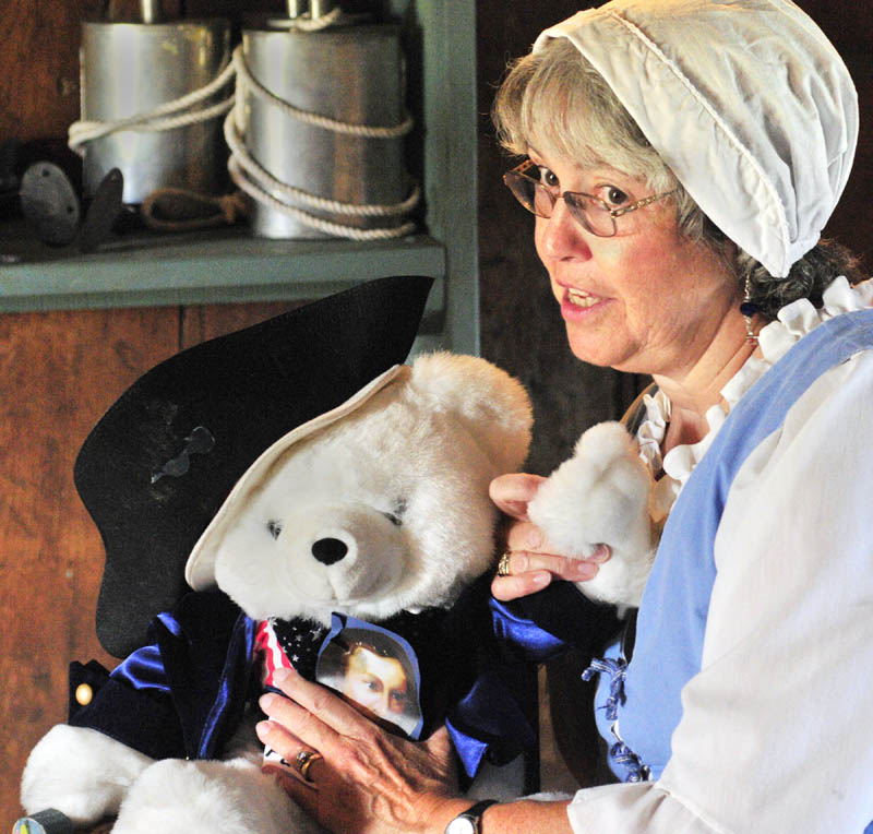 """American Revolution member Bonnie Wilder talks about a Patrick Henry toy bear as she begins her """"Meet the 1787 Framers"""" program that was part of the 225th anniversary of the US Constitution events on Saturday afternoon at Old Fort Western in Augusta."""