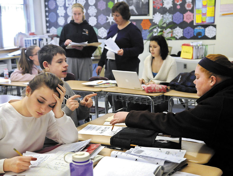 Hall-Dale High School students work on a geometry lesson last year in Kendra Guiou's classroom in Farmingdale. Most area high schools start classes at times that sleep experts say run counter to adolescent biology.