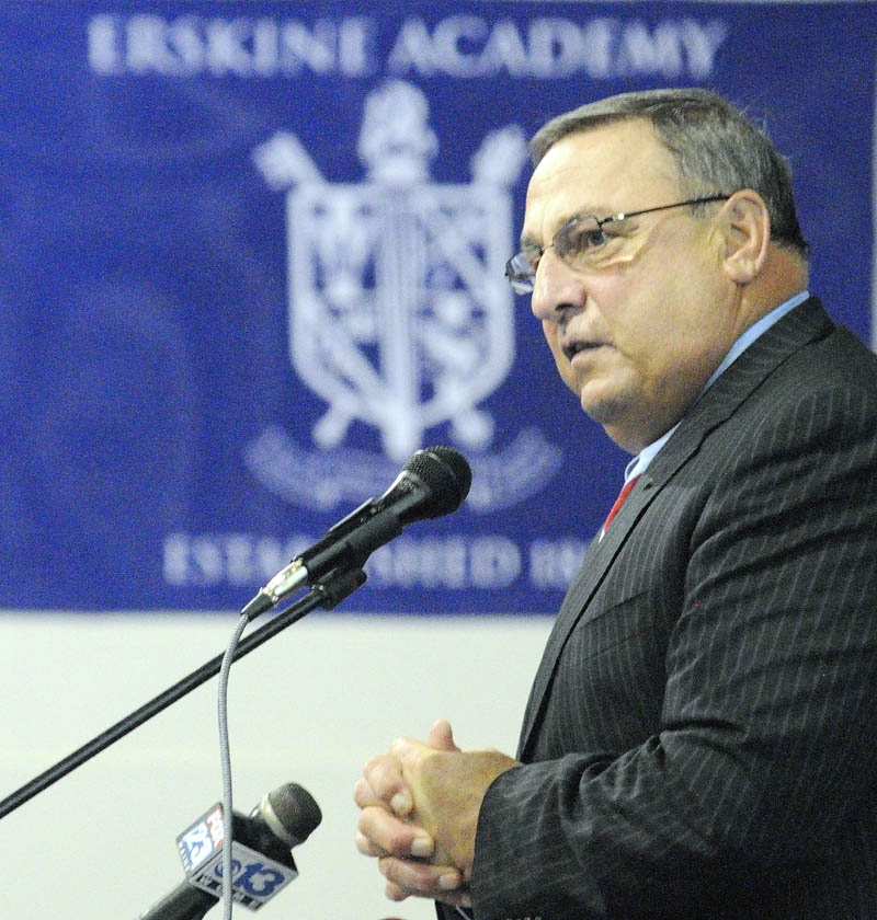 Staff photo by Joe Phelan Gov. Paul LePage speaks to students assembled in the gym on Wednesday afternoon at Erskine Academy in China. LePage spoke about stopping domestic abuse and violence. After speaking the governor took questions from the audience.