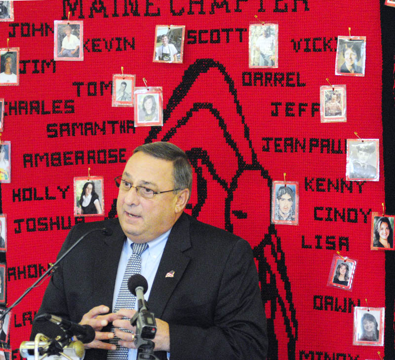 Staff photo by Joe Phelan Gov. Paul LePage speaks at the 6th Annual Maine Day of Rememberance for Murder Victims on Tuesday afternoon at the University of Maine at Augusta.